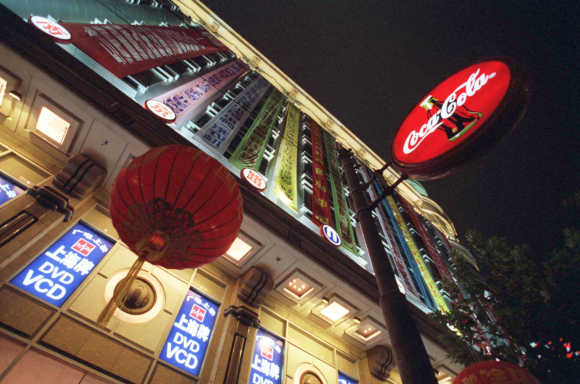 A Coca-Cola sign hangs outside one of Shanghai's biggest department stores.