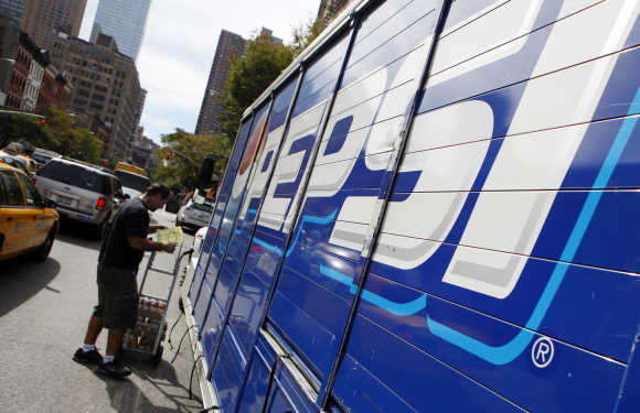 Workers unload a truck of Pepsi products in New York.