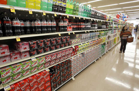 A shopper walks by the sodas aisle at a grocery store in Los Angeles.