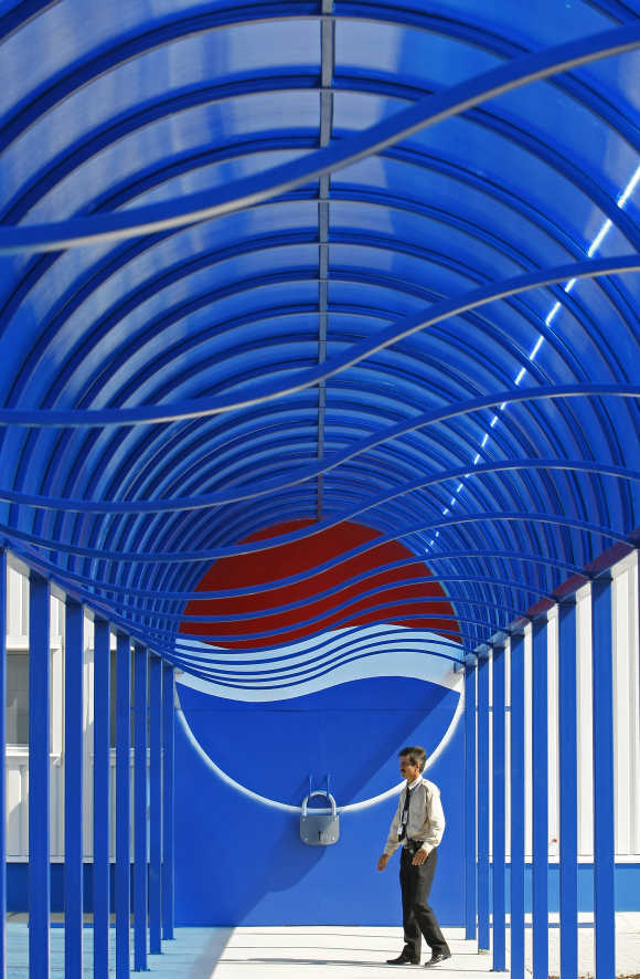 A security officer walks past the entrance of the second-largest European Pepsi plant near Bucharest.