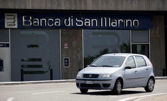 A car passes a branch of the Banca di San Marino in San Marino.