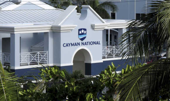 The logo of the Cayman National Bank is pictured on a branch in George Town.