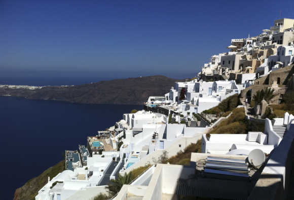 Houses are seen at edge of the caldera at the volcanic island of Santorini.