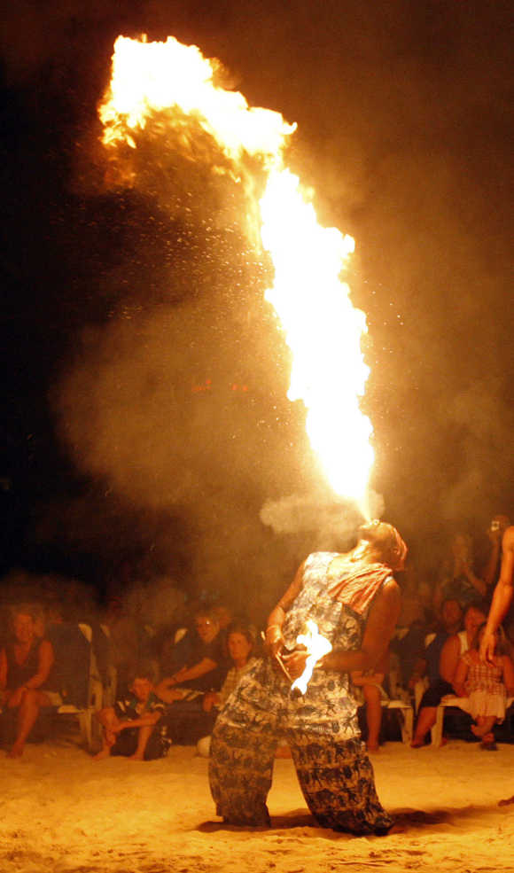 A Jamaican performer blows a flame during a show at a resort hotel in Ocho Rios.