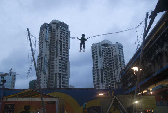 A boy plays on a giant trampoline at a mall in Mumbai.