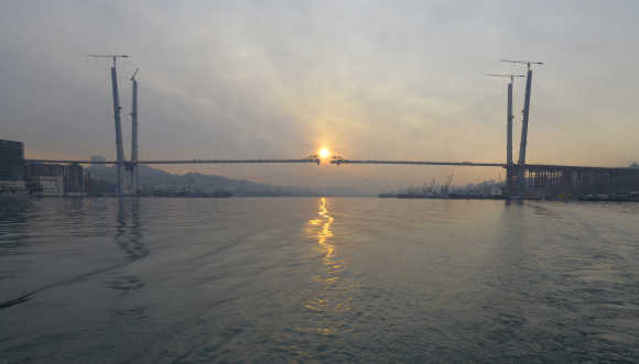 A bridge over the Golden Horn Bay is seen under construction during sunrise in the far eastern port of Vladivostok.
