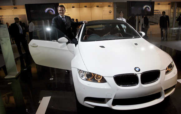 Peter Kronschnabl, President, BMW India, with M3 Coupe in New Delhi.
