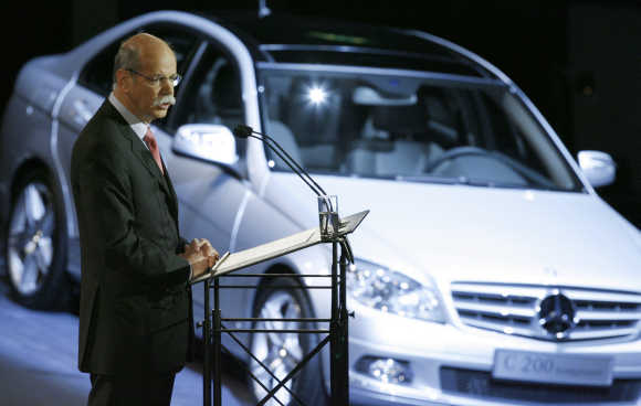 DaimlerChrysler's CEO Dieter Zetsche in front of a Mercedes C-class in Berlin.