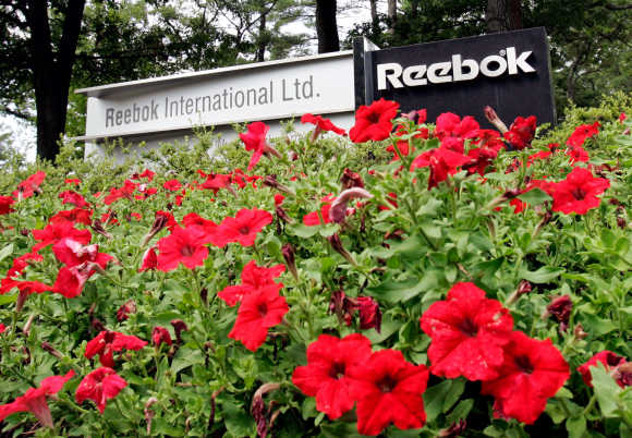 Flowers surround sign at entrance to world headquarters of Reebok in Canton, Massachusetts.