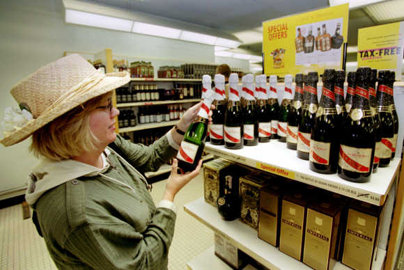 A customer purchases a bottle of champagne at one of the duty free shops at Schiphol airport in Amsterdam.