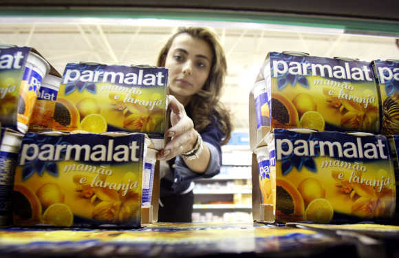 A Brazilian consumer buys a Parmalat product in a supermarket in Sao Paulo.