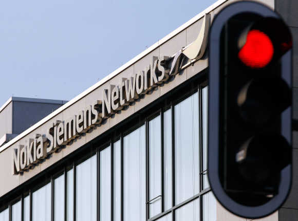 A red traffic light is seen next to the German headquarters of Nokia Siemens Networks in Munich.