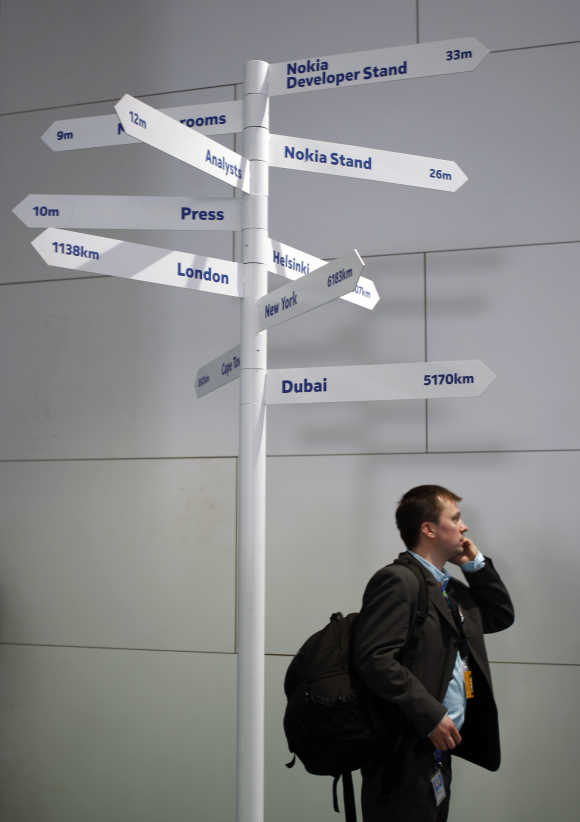 A man walks past a Nokia area at the Mobile World Congress in Barcelona.