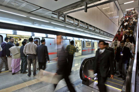 Passengers arrive to an underground metro train station in New Delhi.