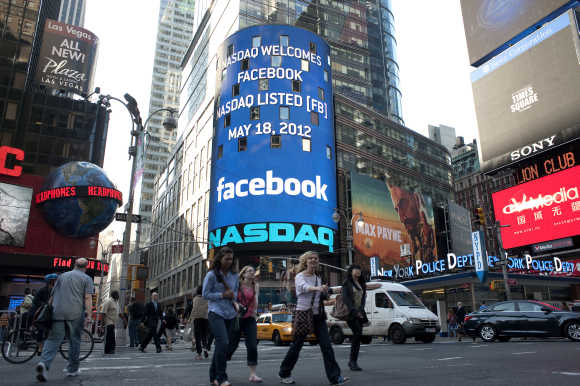 A monitor shows a welcoming message for Facebook's listing on the Nasdaq Marketsite prior to the opening bell in New York.