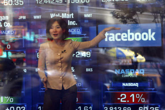 A television reporter talks about the Facebook IPO at the Nasdaq Marketsite in New York.