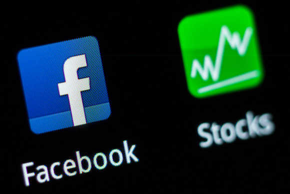 A Facebook application logo is pictured on a mobile phone in this photo illustration taken in Lavigny, Switzerland.