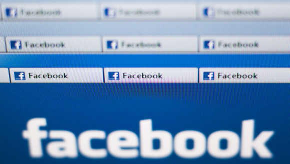 Facebook website pages opened in an internet browser are seen in this photo illustration taken in Lavigny, Switzerland.