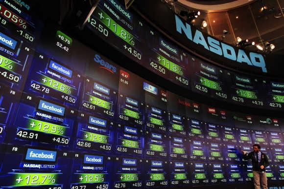 Facebook's share prices are seen inside the Nasdaq Marketsite in New York.