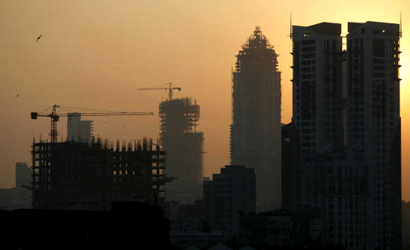 Buildings under construction are seen under the Mumbai skyline.