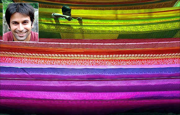 Sandip Sukhtankar, inset. A worker arranges a saree as it is hung out to dry after dyeing it at a