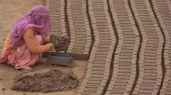 A labourer works in a brick factory at Togga village, in the outskirts of Chandigarh.