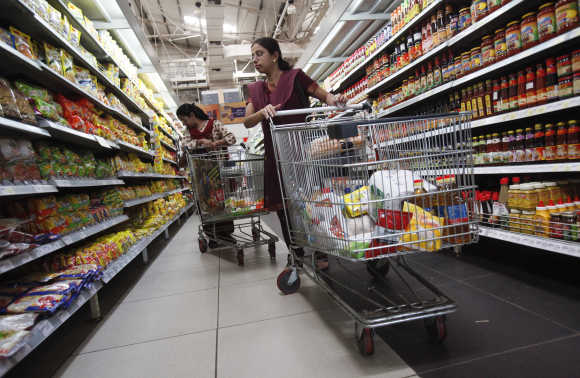 Women shop for instant noodles at a retail supermarket in Mumbai.