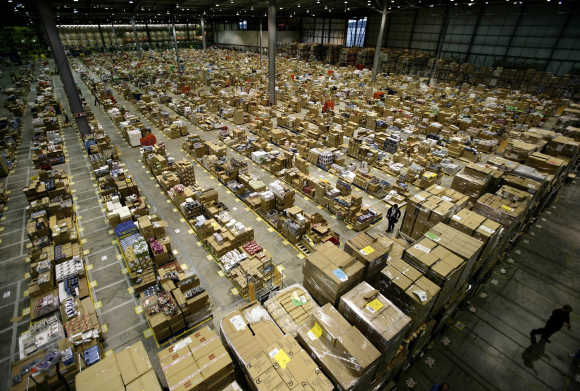 Workers are seen in the Amazon.co.uk warehouse in Milton Keynes, north of London.