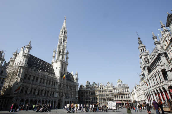 Tourists walk on Brussels' famous Grand Place.