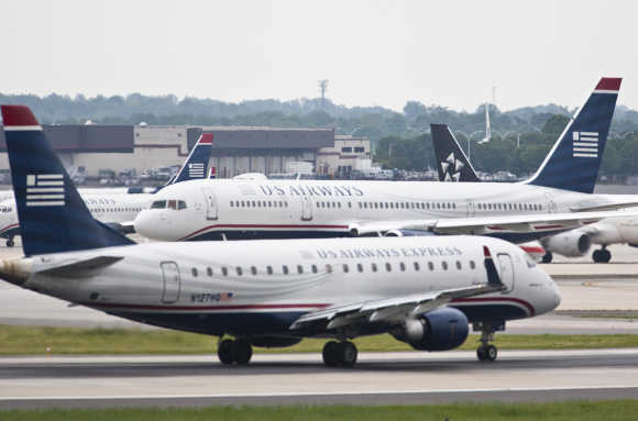 US Airways jets taxi on the tarmac in Charlotte, North Carolina.