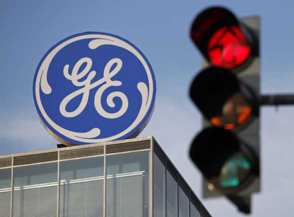 The logo of the GE is seen behind a traffic light in Prague.