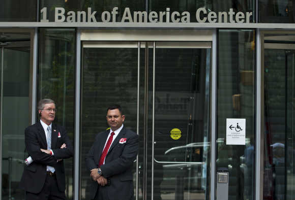 Bank of America security guards stand outside as an annual shareholders meeting takes place in Charlotte, North Carolina.
