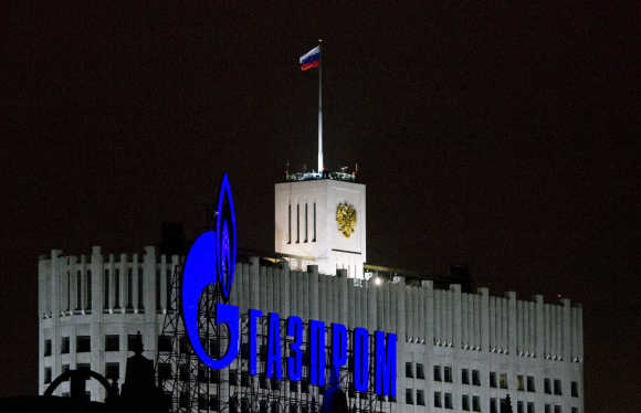 A Gazprom sign is seen in front of the White House, the seat of Russia's prime minister, in Moscow.