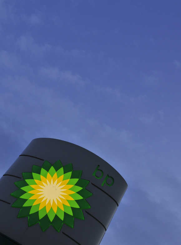 A BP petrol station sign is seen at dawn in west London.