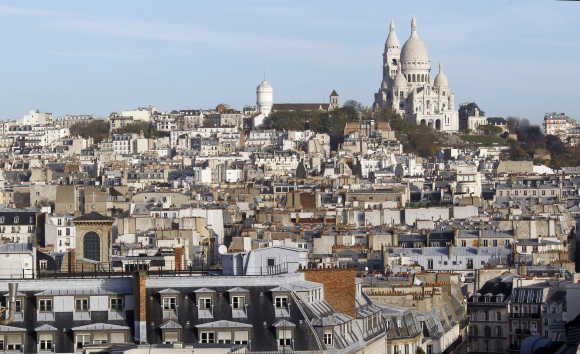 View of rooftops and the Sacre Coeur Basilica on Montmartre in Paris.