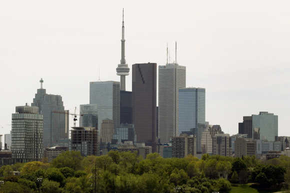 The Toronto Skyline with a condominium building under construction is shown in downtown Toronto.