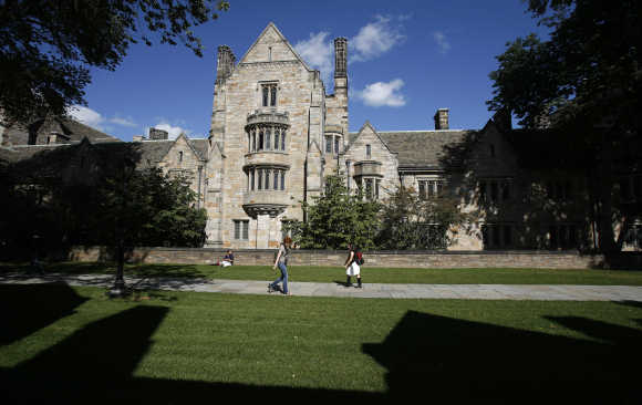 Students walk on the campus of Yale University in New Haven, Connecticut.