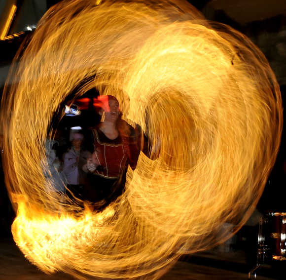 A girl performs a fire show during the winter festival at the Mavrovo ski resort, 100km west from the Macedonian capital of Skopje.