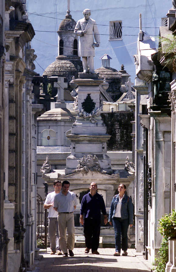 People walk past statues and mausoleums at Buenos Aires' Recoleta cemetery.