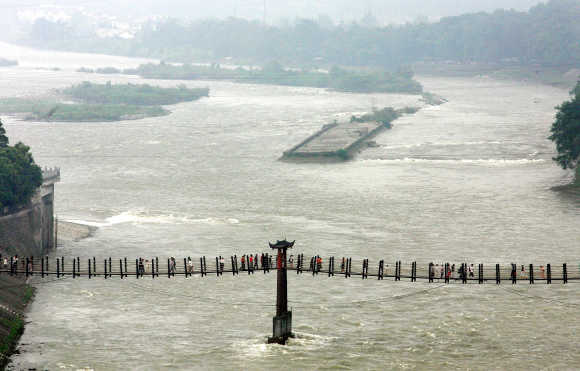 Visitors cross part of a 260-metre Anian cable bridge over Minjiang River at Dujiangyan, 50km north of Chengdu.