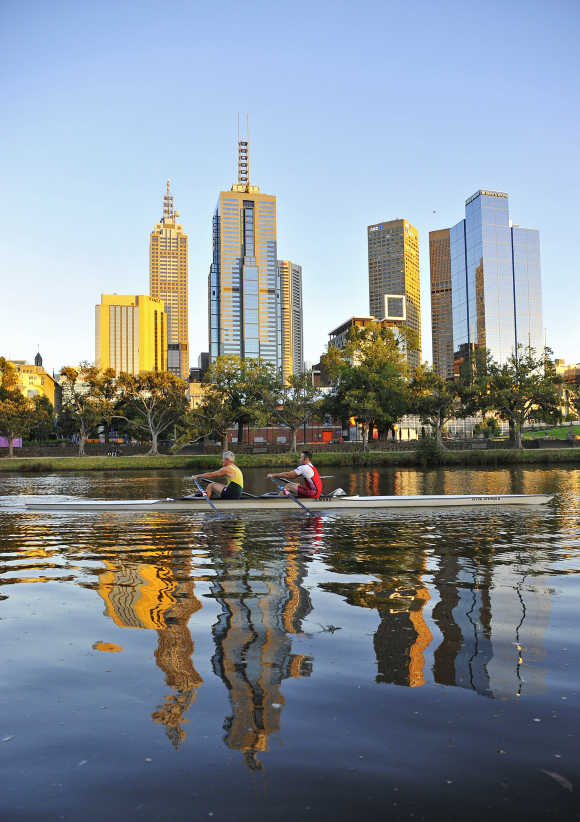 Rowers train at dawn on the Yarra River in Melbourne.