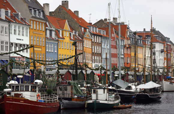 Boats are seen anchored at the 17th century Nyhavn d