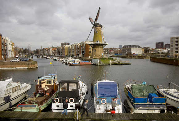 The Distilleerketel, a windmill built in 1727 and used to grind rye, can be seen at Delfshaven, an area of Rotterdam, the Netherlands.