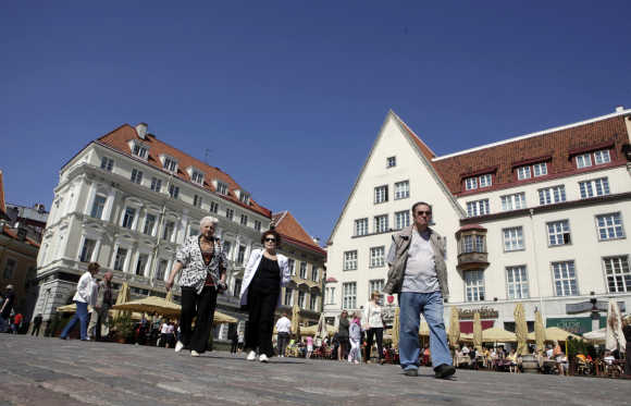 Tourists gather at the City Hall square in Tallinn.