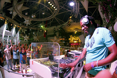 Tourists waves to a DJ inside Paradis disco in San Antonio in the Spanish Balearic island of Ibiza.