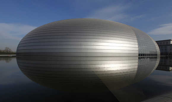 The National Grand Theatre, also known as the 'egg', is reflected in the water in central Beijing.