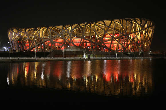 National Stadium, also known as 'Bird's Nest', is seen before Earth Hour in Beijing.