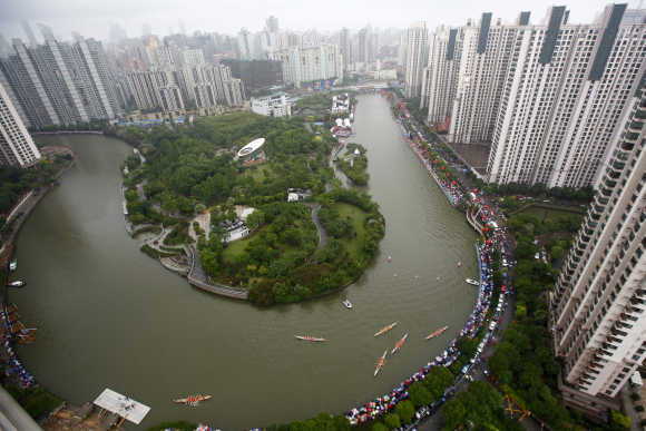 Aerial view shows boats participating in dragon race on Suzhou river in Shanghai.