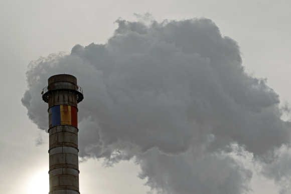 Romania's national flag is seen painted on a tower of a thermal energy production factory in Bucharest.