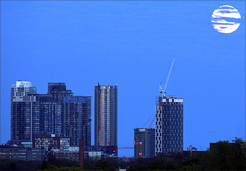The super Moon rises over some apartment buildings in Toronto.